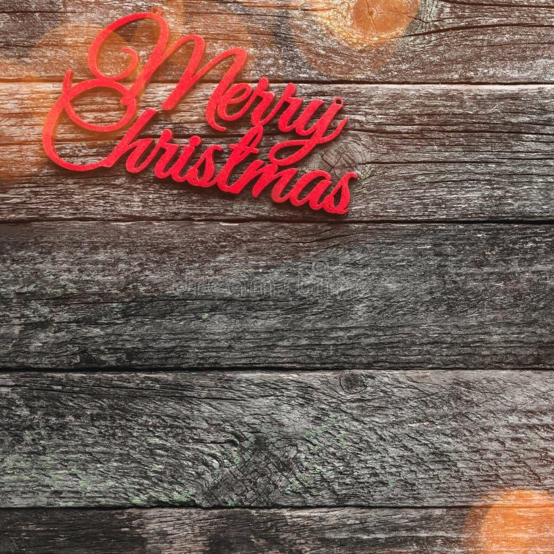 Fundo quadrado de madeira velho Inscrição alegre do Natal vermelho, espaço para o texto Vista superior fotografia de stock royalty free