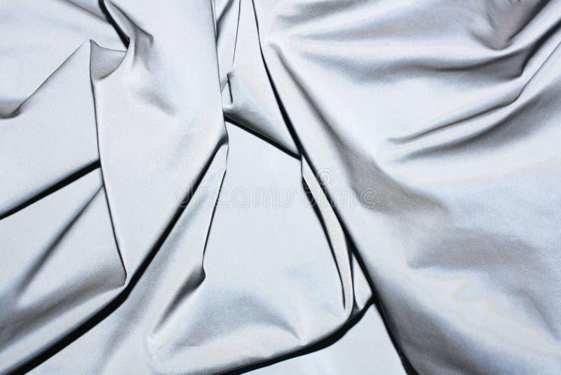 Fundo reflexivo da tela do refletor do tecido imagens de stock