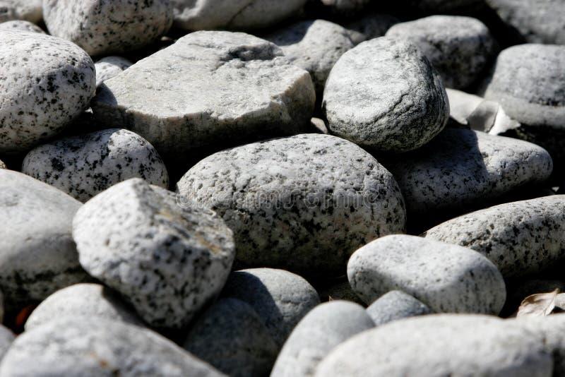 Fundo/textura - rochas secas do rio imagem de stock royalty free