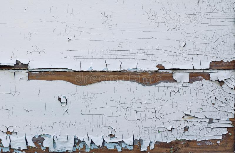Fundo Textured das placas idosas cobertas com a pintura branca rachada da idade avan?ada imagem de stock royalty free