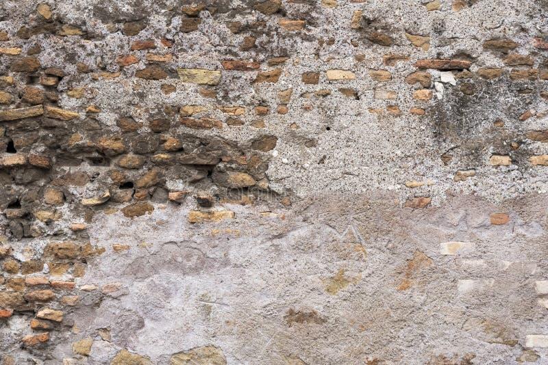 Fundo urbano da textura concreta velha da parede de tijolo do emplastro fotografia de stock