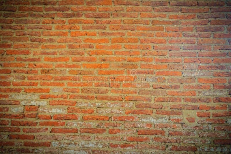 Fundo velho abstrato da textura da parede do tijolo vermelho Arruina o cru desigual imagens de stock royalty free