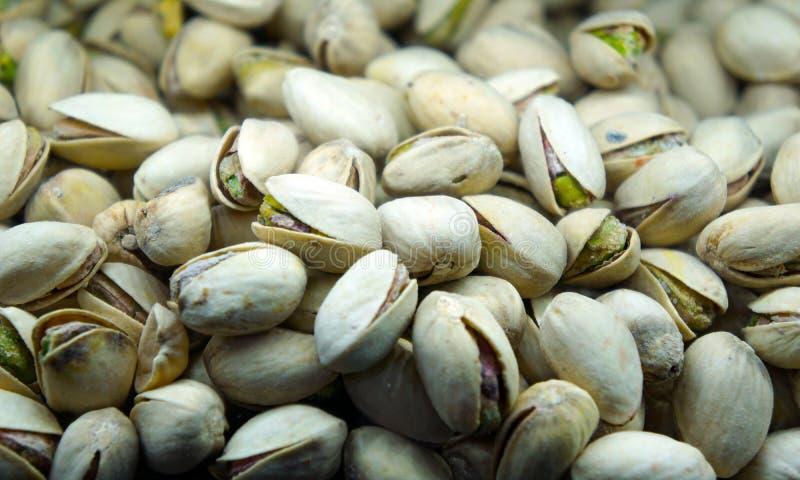 Fundo verde da textura do petisco dos pistaches imagem de stock royalty free