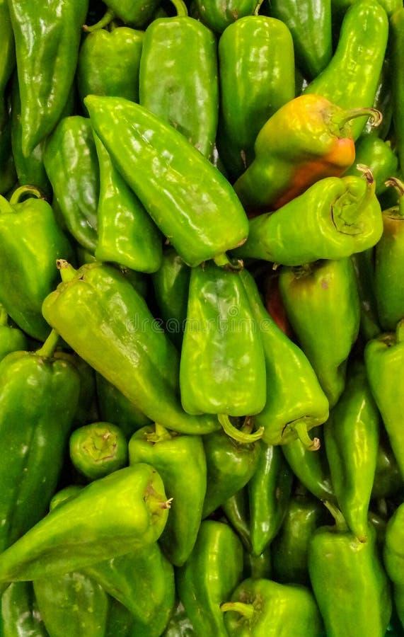 Fundo verde das paprika fotos de stock royalty free