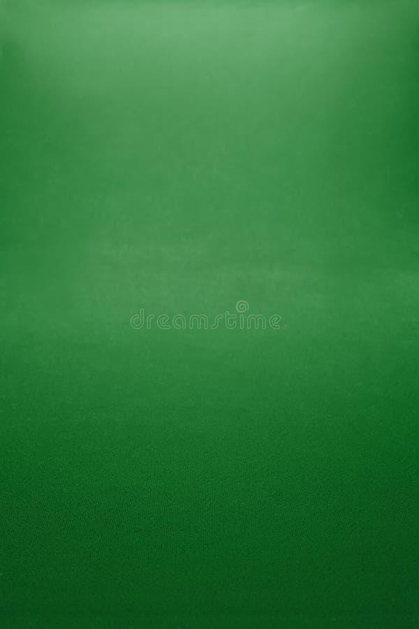 Fundo verde de matéria têxtil fotografia de stock royalty free