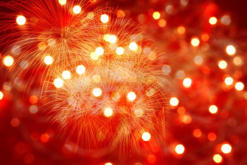 Fundo vermelho com luzes e fogos-de-artifício imagem de stock royalty free