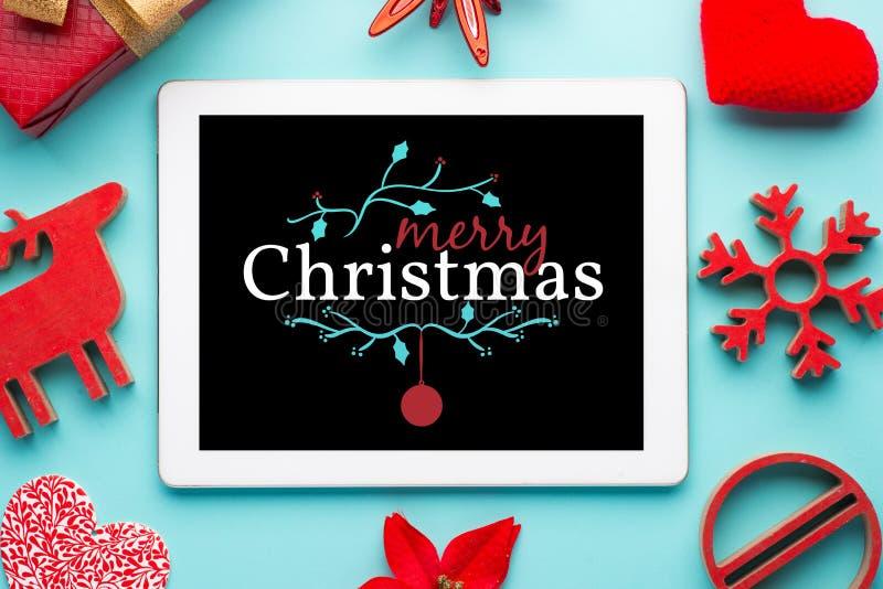 Fundo vermelho do Natal da tabuleta foto de stock royalty free