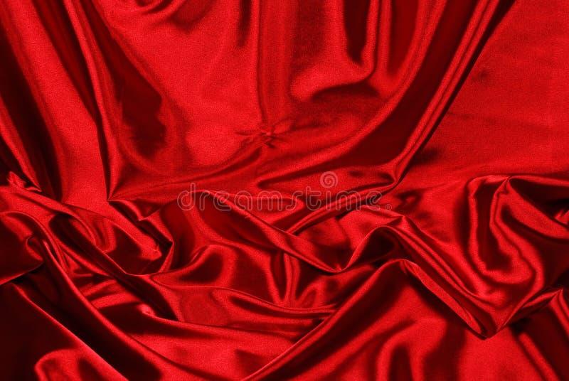 Fundo vermelho elegante do cetim fotografia de stock