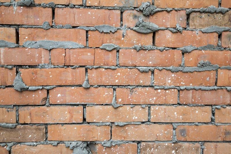 Fundo vestido velho vermelho da textura da parede de tijolo foto de stock