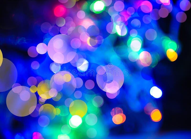 Fundos abstratos dos feriados com bokeh e luzes da beleza imagem de stock