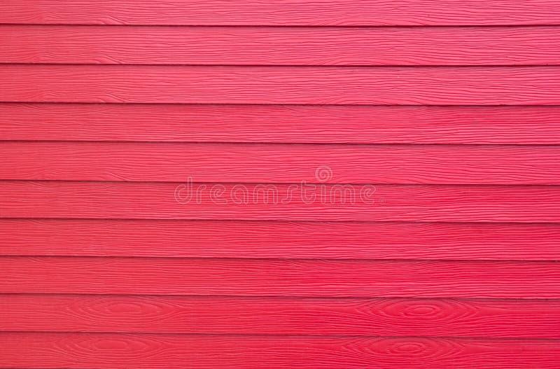 Fundos de madeira vermelhos artificiais foto de stock royalty free