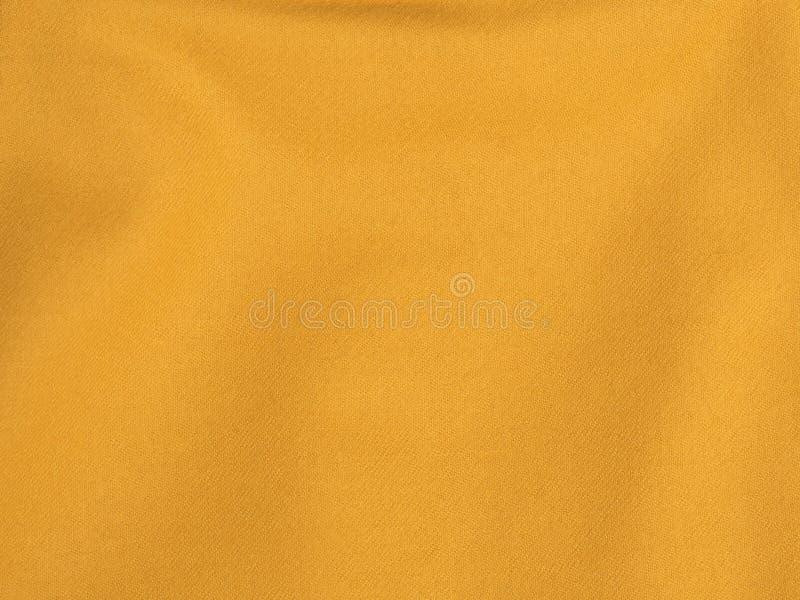 Fundos e texturas Close-up alaranjado do tecido de algodão fotografia de stock