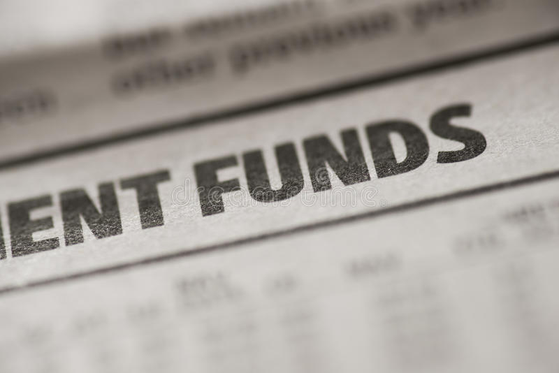 Funds. Written funds on real newspaper with shallow dof stock photo