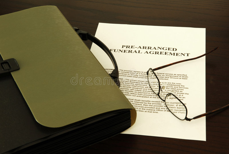 Funeral agreement. Bag, paper and glasses royalty free stock image