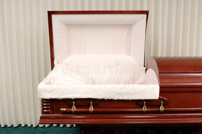Funeral Casket. Wooden casket made of Cherry in a funeral home stock image