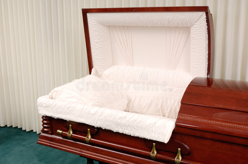 Funeral Casket. Wooden casket made of Cherry in a funeral home royalty free stock images