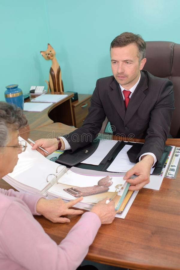 Funeral director receiving client. Young stock photography