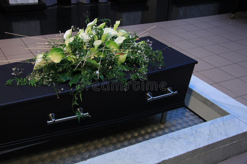 Funeral flowers on a casket. Funeral service royalty free stock photos