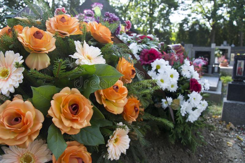 Funeral flowers, flowers on the grave. Sad view stock photography