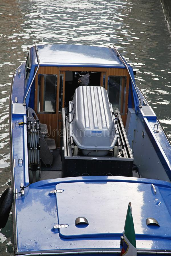 Casket in Boat. Funeral Hearse Boat With Casket in Venice Canal royalty free stock photos