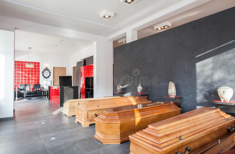 Funeral office with coffins. Coffins and urns in a funeral office royalty free stock photo