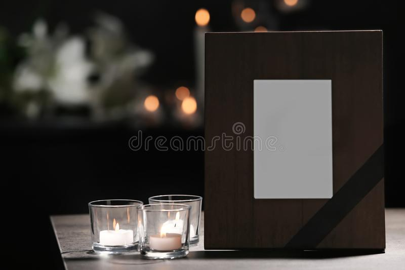 Funeral photo frame with black ribbon royalty free stock photos