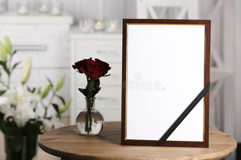 Funeral photo frame with black ribbon stock photo