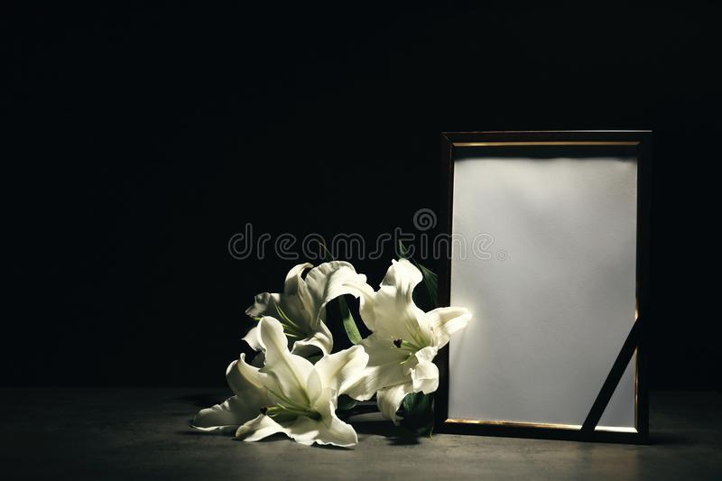 Funeral photo frame and lily flowers stock photos