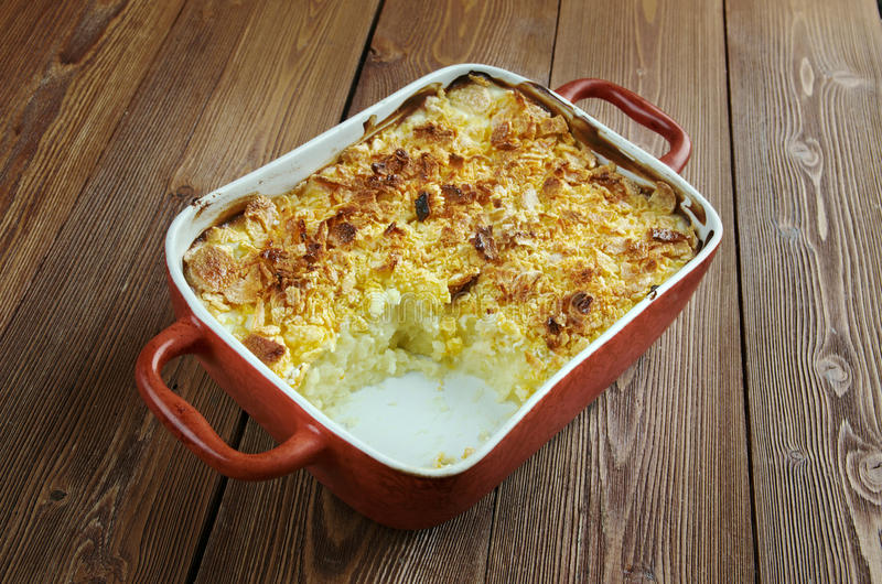 Funeral potatoes. Mormon Funeral Potatoes - traditional potato hotdish, or casserole, un Intermountain West region of the United States. potatoes, cheese royalty free stock photos