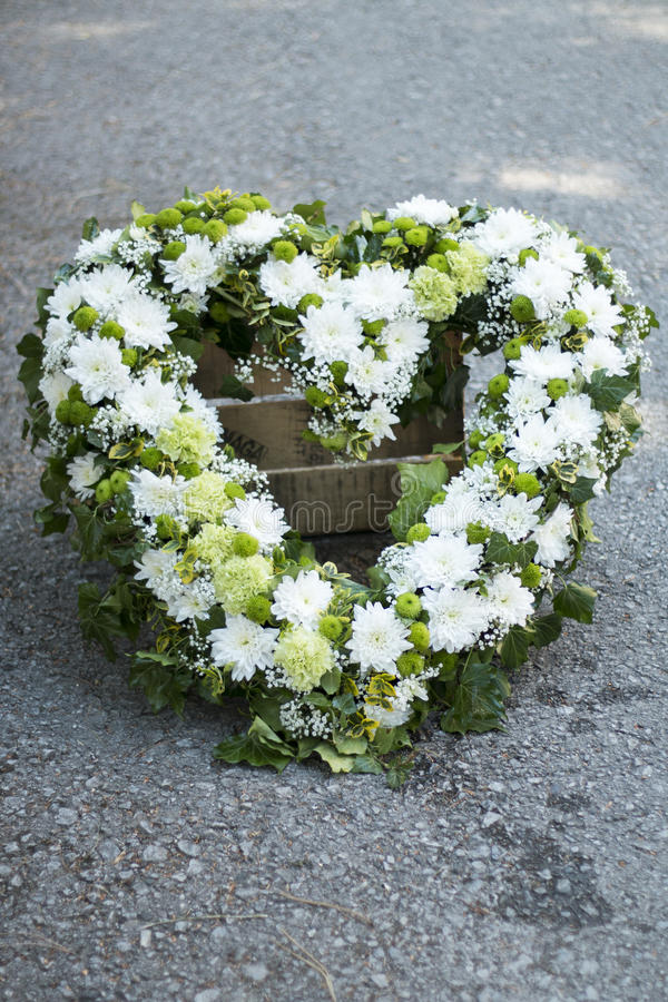 Funeral white wreath. Modern funeral wreath made of white rosees royalty free stock image