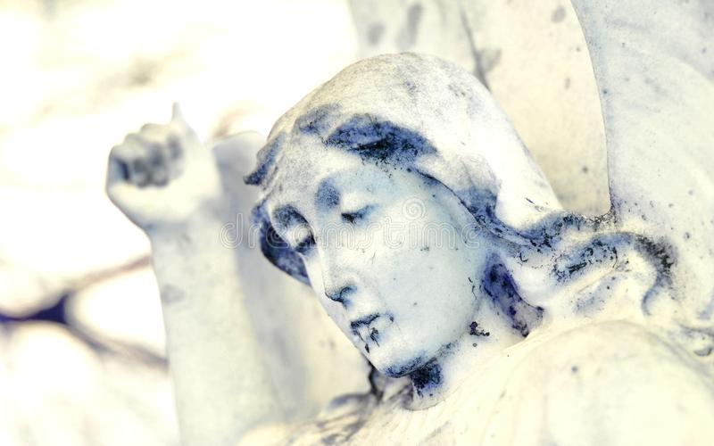 Funerary background. With close-up of marble cherub stock image