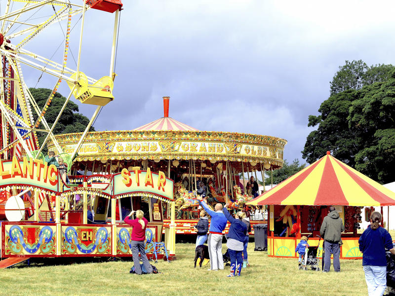 Funfair. All the fun of the fair as families enjoy the rides and stalls of a funfair stock photography
