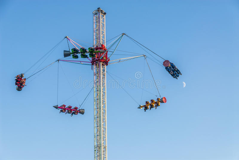 Funfair ride with moon royalty free stock photo