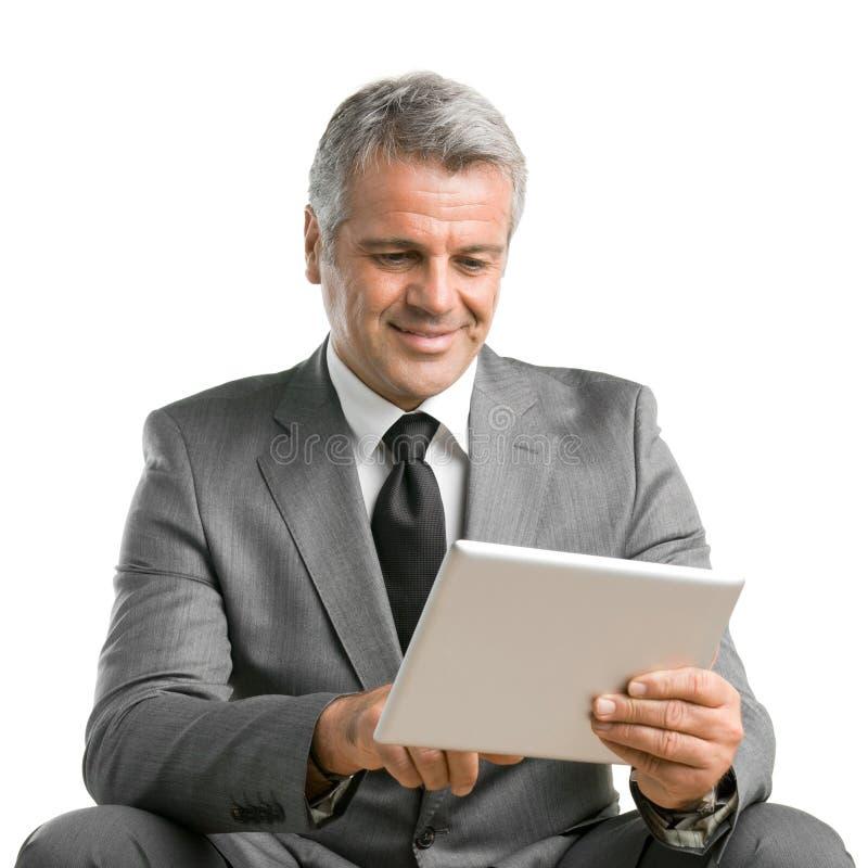 Fungera med den moderna tableten royaltyfria bilder