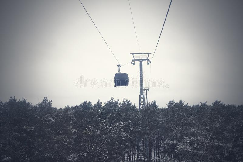 Funicular in bad weather stuck over the forest. Rescue of people royalty free stock image