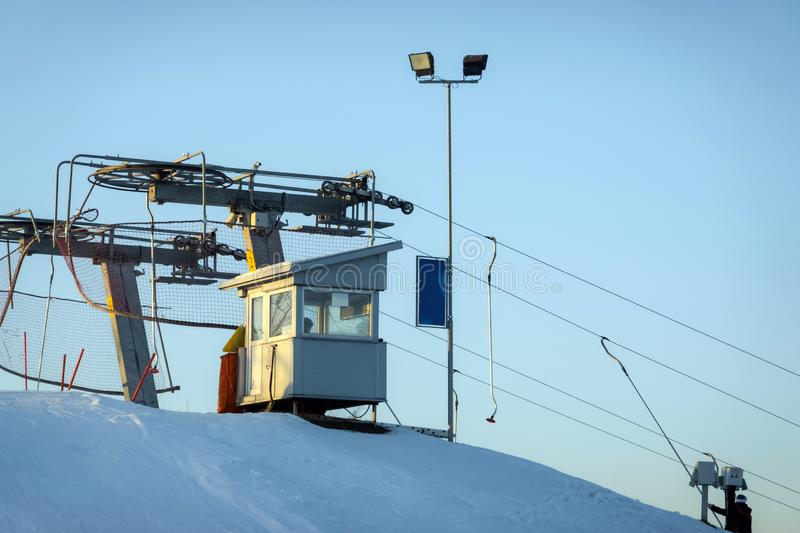 Funicular control cabin on top of the mountain in skiing resort. Cables pulling skiers and snowboarders up the mountain stock photo