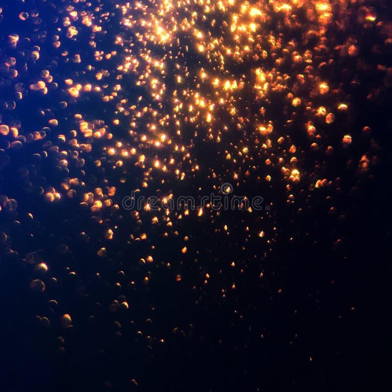 Funkeln beleuchtet abstrakten Hintergrund Goldenes Schein stardust auf b stockfotografie