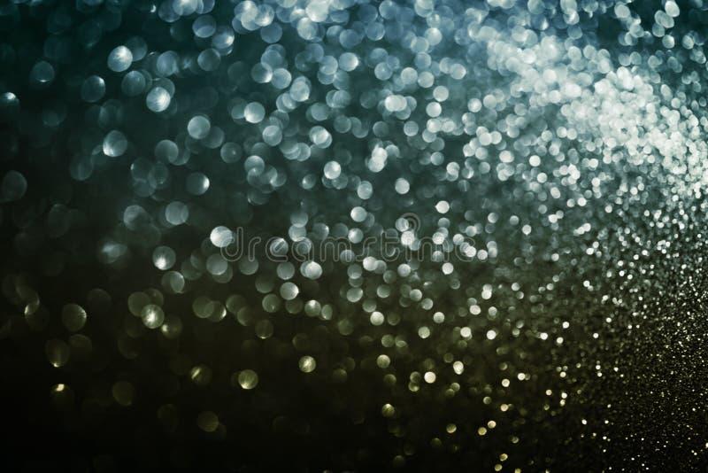 Funkeln bokeh Hintergrund, abstrakte Beschaffenheit von defocused Lichtern, Weinleseblau und Goldfarbe stockfotos