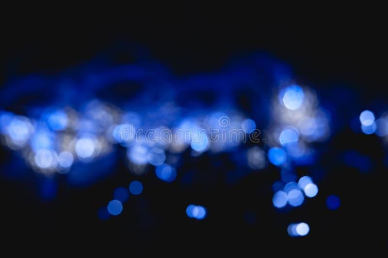 funkelnde blaue Farbe abstrakten bokeh Hintergrundes mit Funkeln kreist ein stockfotos