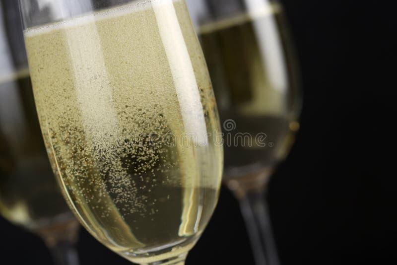Funkelnde Champagne in einem Glas stockbilder