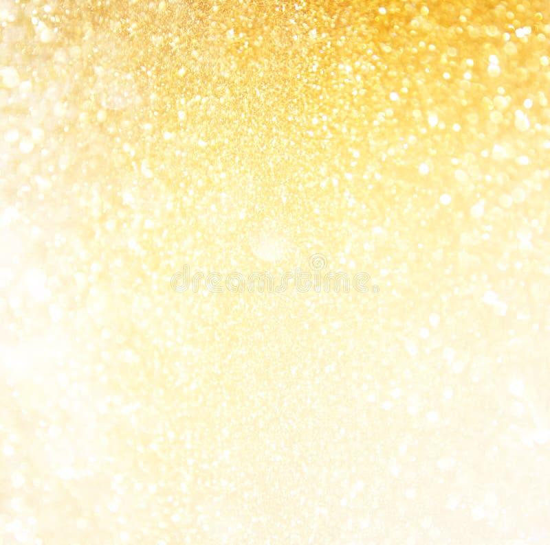Funkelnweinlese beleuchtet Hintergrund Abstrakter Goldhintergrund defocused