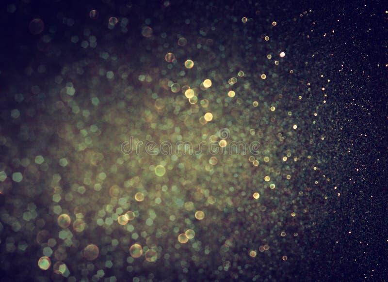 Funkelnweinlese beleuchtet Hintergrund helles Gold und Schwarzes