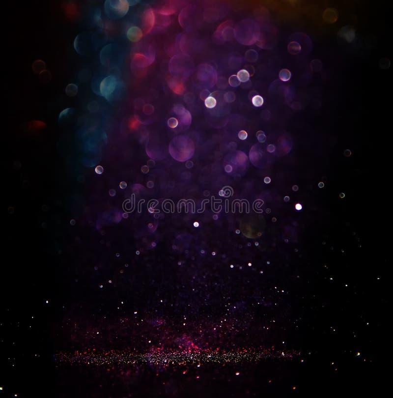 Funkelnweinlese beleuchtet Hintergrund helles Silber, Purpur, Blau, Gold und Schwarzes defocused