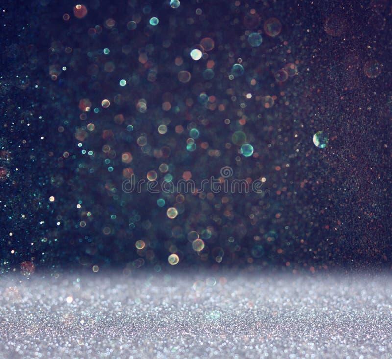 Funkelnweinlese beleuchtet Hintergrund helles Silber und Schwarzes defocused stockfotos