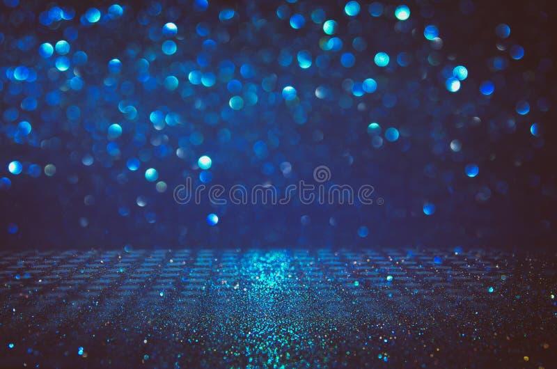Funkelnweinlese beleuchtet Hintergrund Schwarzes, Blau und Silber de-fokussiert stock abbildung