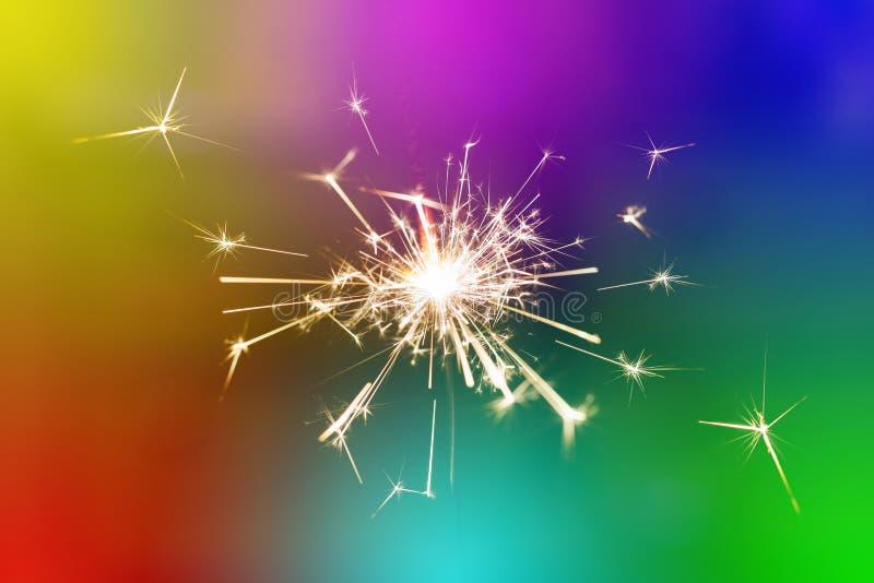 Funken Handvom kalten Feuerwerks-Farbhintergrund lizenzfreies stockfoto