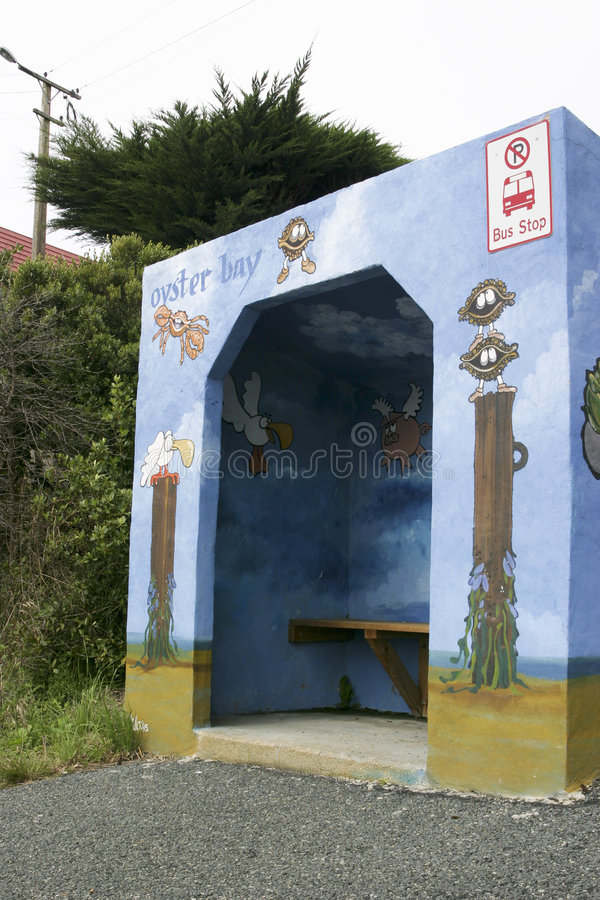 Funky Bus Stop 3. A brightly painted bus stop shelter in the country stock image