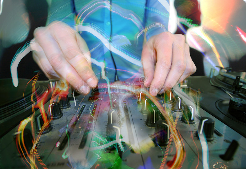 Funky female dj. Close-up of a funky female dj, mixing on turntables with abstract light trails overlayed royalty free stock photo