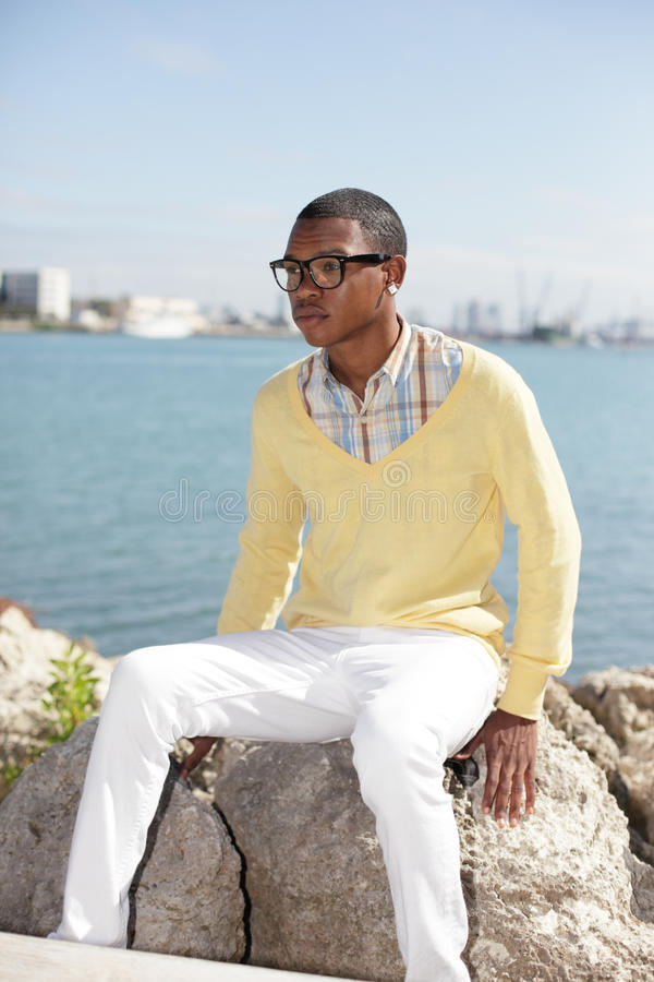 Download Funky Man Sitting By The Water Stock Photo - Image of downtown, image: 22616636