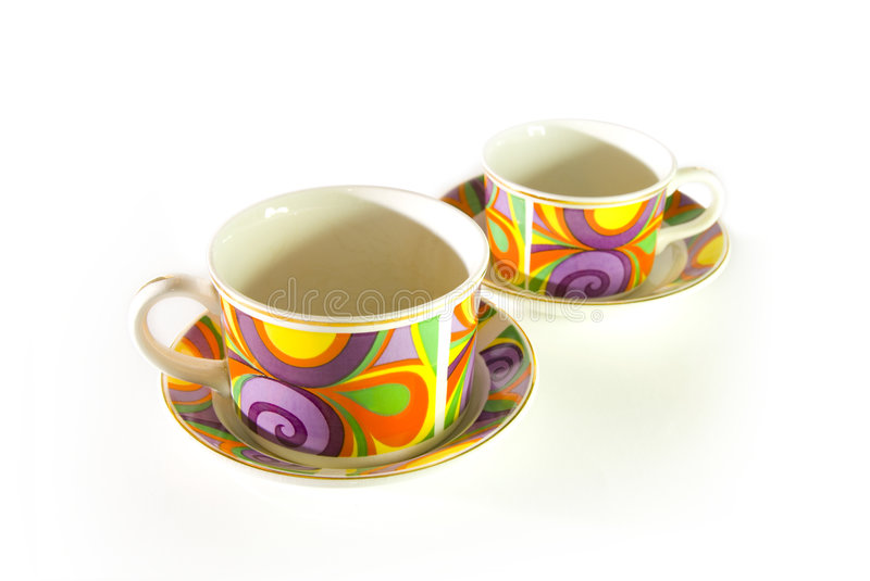 Funky pattern cups. Cup and saucer with funky color pattern stock images